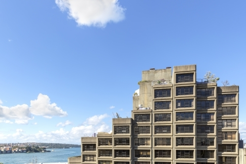 Brutalist apartments with harbour in the background