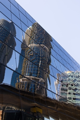 Buildings reflected in modern glass facade