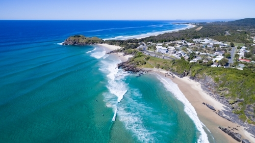 Aerial view of surf and surfers at Cabarita Beach.