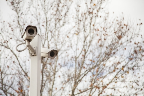 Security speed camera watching cars on overcast day in winter