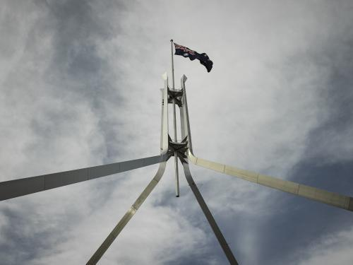 Australian Flag flying at Parliament house seen from below