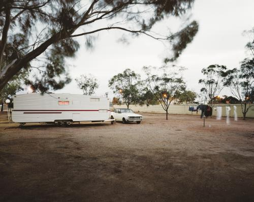 Car and caravan in outback camp ground