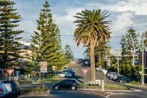 Cars driving around a roundabout in coastal town