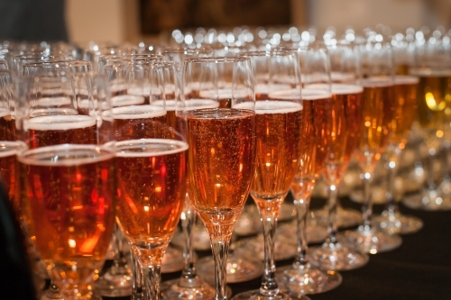 Rows of glasses with sparkling wine
