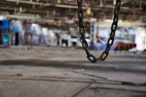 Chain in abandoned warehouse