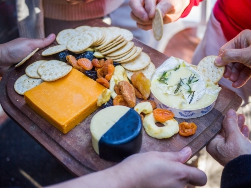 Cheese and crackers cheeseboard being served at a party