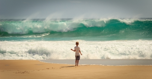 Child and waves at the beach, Yorke Peninsula, South Australia