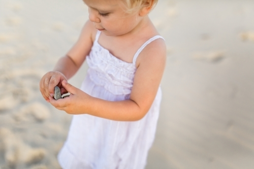 Child collecting shells at the beach