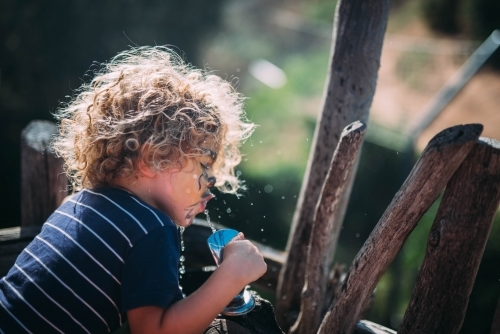 Child drinking from a tap