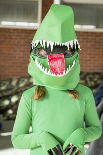 Child in Green Dinosaur Costume