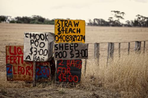 Chook and sheep poo for sale signs beside country road