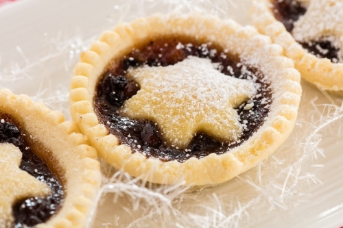 Christmas Fruit Mince Pies on a white tray with white decoration