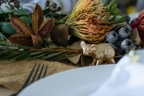 Christmas table setting with native flowers and gold koala ornament
