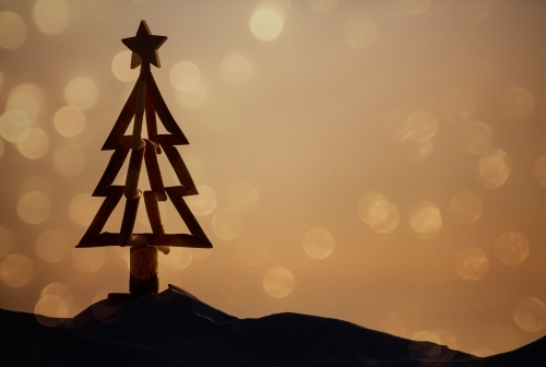 Christmas tree silhouette on beach background