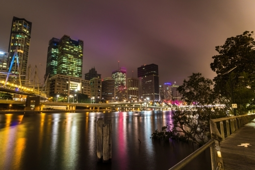 City buildings overlooking the Brisbane River at night