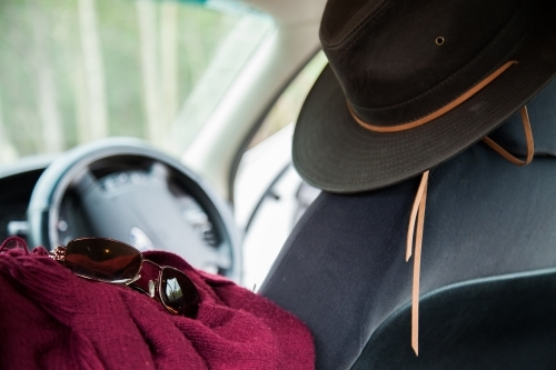 Sunnies and blanket and hat in the back of a car