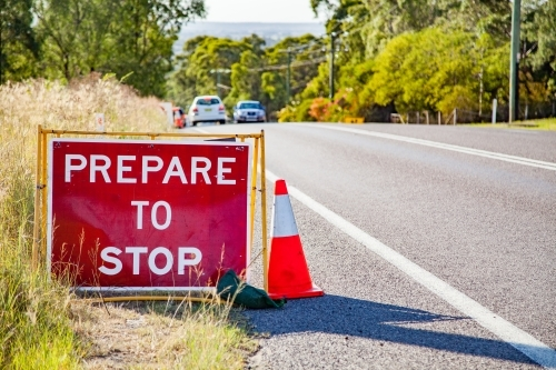 Prepare to stop road work signs on road