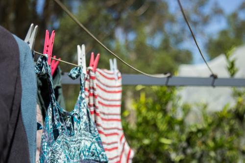 Washing pegged on to a clothes line to dry in the sun