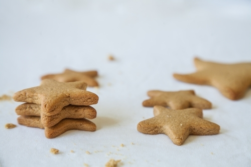 Baked gingerbread christmas star biscuits on white