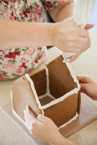Building a gingerbread house for Christmas