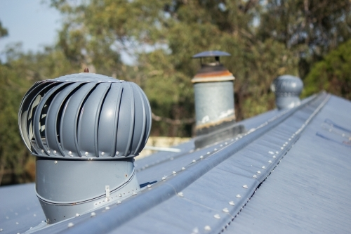 Whirlybird roof vents on tin roof