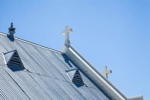 Crosses on the roof of a sunlit country church