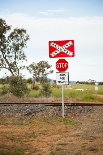 Country railway trainline crossing look for trains stop sign