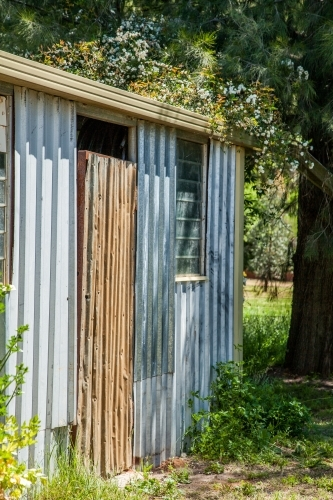 Small corrugated iron garden shed on a farm