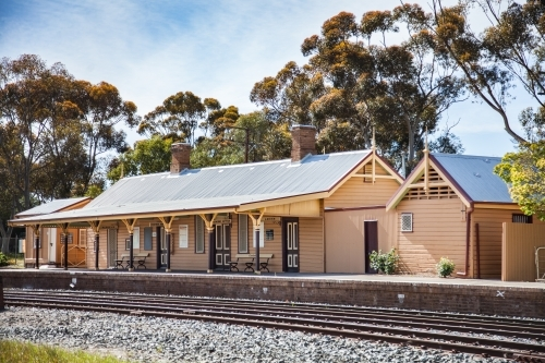 Country train station platform and buildings in Coolamon