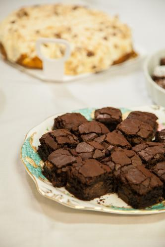 Chocolate brownie slice on a plate set out for a party