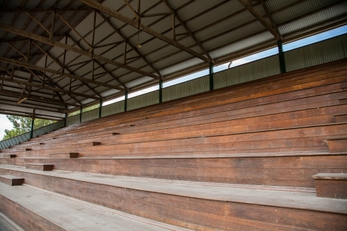 Empty seats of a large grandstand at Singleton Showground