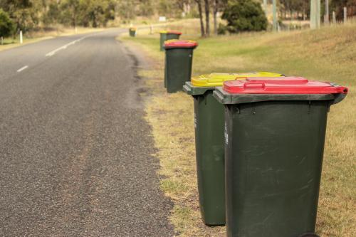 Council bins by the side of a rural road