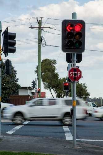 Red traffic light and stop sign at intersection in Newcastle