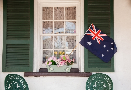 Australian flag in window box flowers on shop front