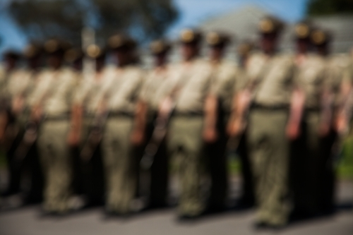 Blurred image of soldiers standing to attention