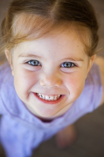 Close up of a happy little girl smiling