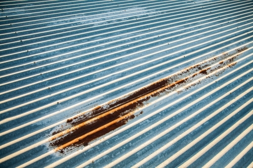 Corrugated iron roof with rusted patch
