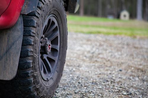 Front wheel of a four wheel drive car on a gravel road