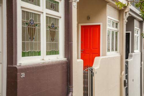 Orange door and windows of houses on a Newcastle street