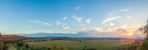 Panorama view of rural farms and paddocks of Long Point at sunset