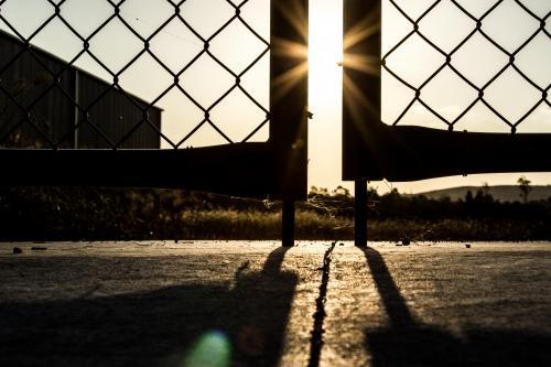 Sunset through silhouetted gates