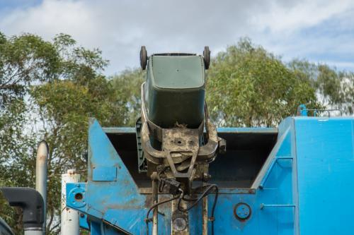 Rubbish being tipped into a garbage truck