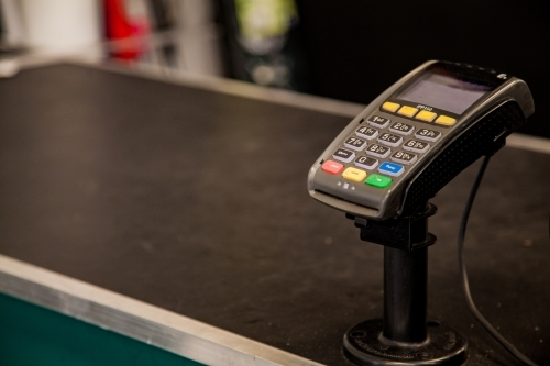 Black copy space with credit card terminal at checkout