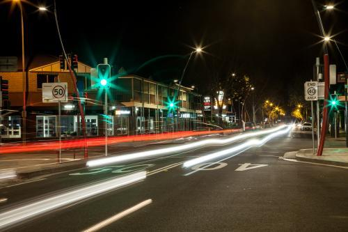 Long exposure streetscape of traffic lights in small town at night