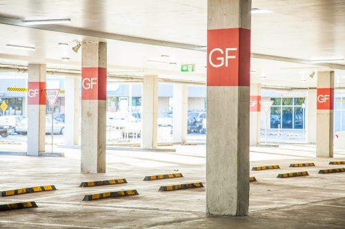 Empty ground floor car park at shopping centre
