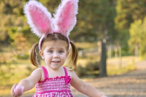 Little girl dressed up for Easter playing outside