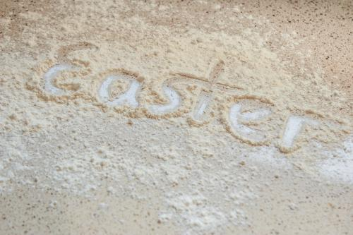 Easter written in flour on the kitchen bench