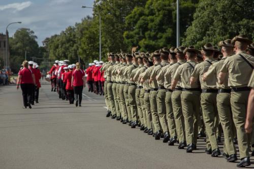 Soldiers and town band marching on ANZAC Day