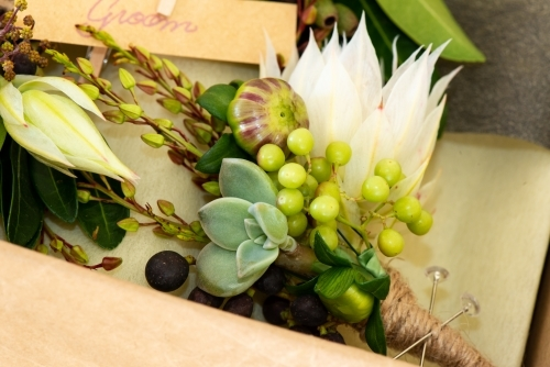 Close up of a groom's buttonhole or boutonniere ready to be packaged