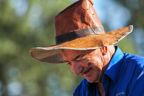 Close up of an old farmer with home made leather hat.